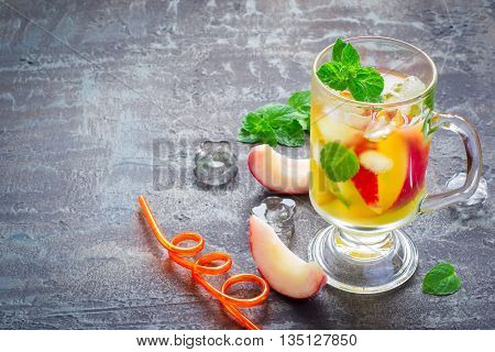summer drink Peach Sweet Tea with ice and mint, copy space.