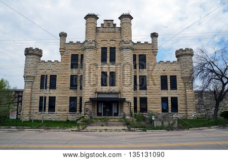 JOLIET, ILLINOIS / UNITED STATES - MAY 3, 2015: The former women's building of the old Illinois State Penitentiary, built in 1896, now abandoned.