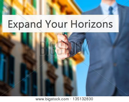 Expand Your Horizons - Businessman Hand Holding Sign