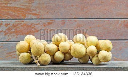 fresh fruit longkong on the wood background