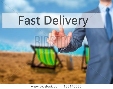 Fast Delivery - Businessman Hand Pressing Button On Touch Screen Interface.
