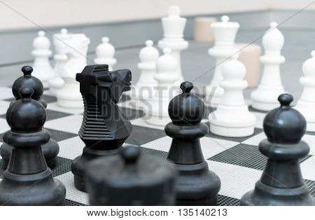 Outdoor Chess Board With Big Plastic Figures.
