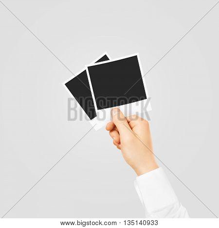 Hand holding blank photo frames mockup. Empty old photography template mock up. Vintage decorative photo design element.