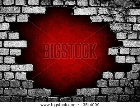 large hole in brick wall