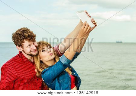 Young Couple Taking Self Picture Selfie With Tablet