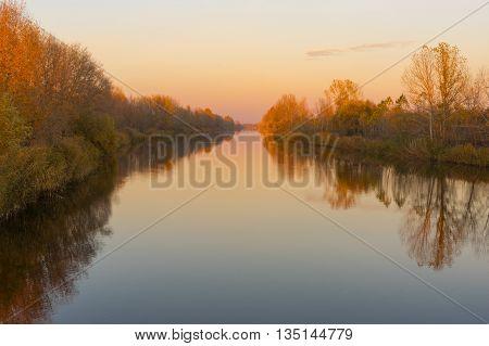 Autumnal landscape with Ukrainian river Orel at sunset time
