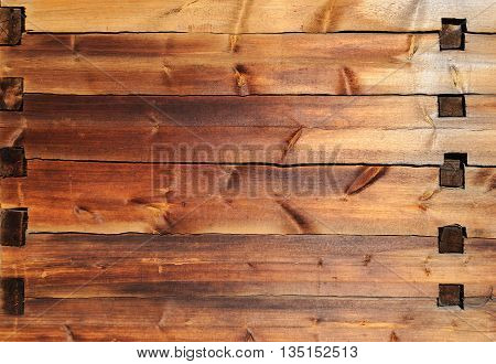 Texture of old wooden wall with mortise and tenon joint