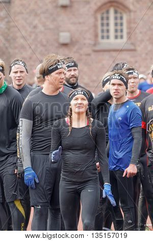 STOCKHOLM SWEDEN - MAY 14 2016: Woman waiting to sprint towards the rampage obstacle in the obstacle race Tough Viking Event in Sweden May 14 2016
