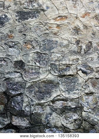 Grey stone texture background closeup. Stonework cement works