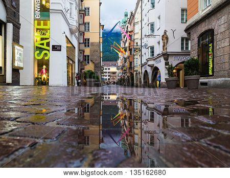 INNSBRUCK AUSTRIA - 18TH JUNE 2016: A view along Herzog Friedrich Strasse towards the Golden Roof building. People can be seen.