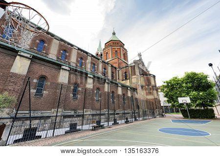 Milan (Lombardy Italy): church of Santa Maria di Lourdes exterior: basketball court