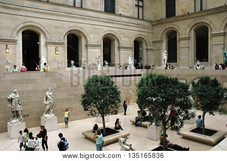 PARIS, FRANCE - AUGUST 18 2006: Tourists visit sculpture gallery in Museum