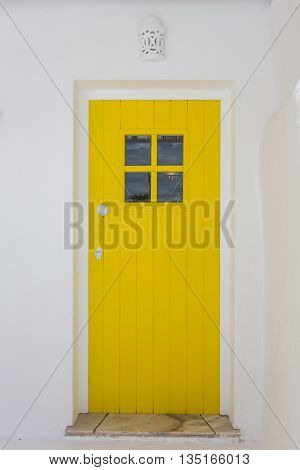 Vintage Portuguese door with a national ornament. Yellow.