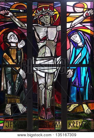 KLEINOSTHEIM, GERMANY - JUNE 08: 12th Stations of the Cross, Jesus dies on the cross, stained glass window in Saint Lawrence church in Kleinostheim, Germany on June 08, 2015.