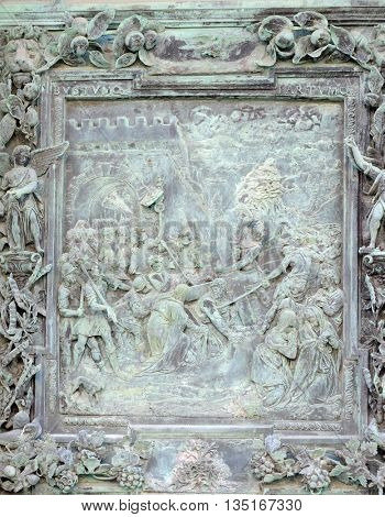 PISA, ITALY - JUNE 06, 2015: Jesus Christ's ascent to the Calvary, sculpture work from Giambologna's school, portal panel of the Cathedral St. Mary of the Assumption in Pisa, Italy on June 06, 2015