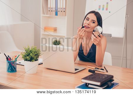 Pretty Happy Businesswoman Doing Make Up In Office
