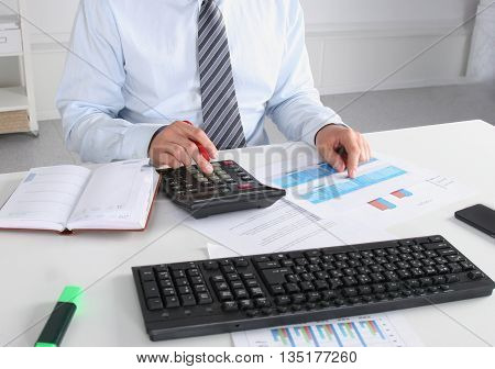 Business Man Sitting On The Desk And Working In His Office