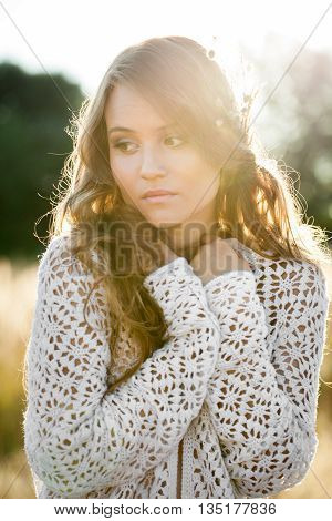 Beautiful Young Lady Model Posing In A Field At Sunrise