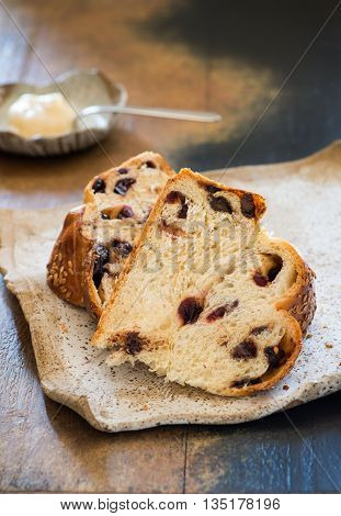 Sweet challah bread with chocolate and cranberries slised closeup