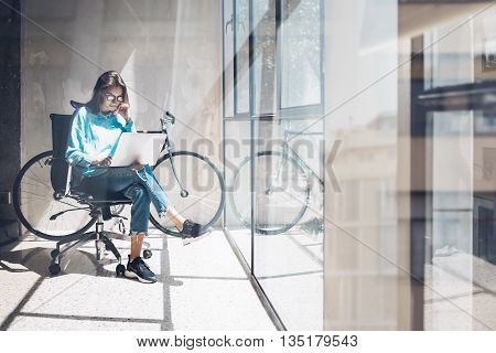 Blogger Hipster use Notebook Agency Loft Studio.Student Researching Process Home.Young Woman Working Business Startup modern Office.Analyze new creative market strategy.Blurred, film effect.Horizontal