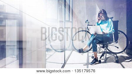 Blogger Hipster use Notebook Agency Loft Studio.Student Researching Process Home.Young Woman Working Business Startup modern Office.Analyze new creative market strategy.Blurred, film effect.Wide