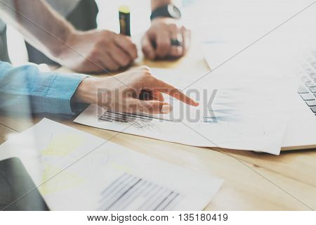 Trade Managers Working Modern Studio.Woman Showing Hand Market Report Charts.Marketing Department Planning New Strategy.Researching Process Wood Table.Horizontal.Blurred Background.Film effect