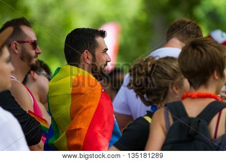 Boise, Idaho/usa - June 20, 2016:man In The Crowd Wearing A Rainbow Flag During Boise Pridefest