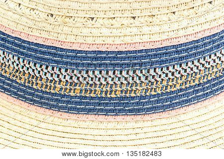 Woven straw background or texture. Brown blue pink yellow color.