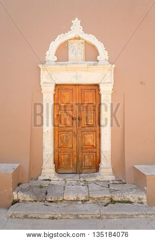 Door of old building in Hersonissos on Crete Greece.