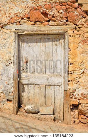 Door of old building in Hersonissos on Crete Greece.