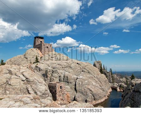 Harney Peak Fire Lookout Tower in Custer State Park in the Black Hills of South Dakota USA with snowmelt water below it poster