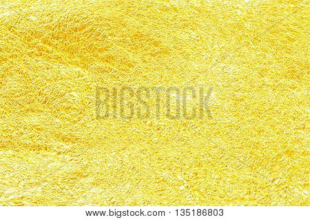 Shiny yellow leaf gold foil texture for background. Crease poster