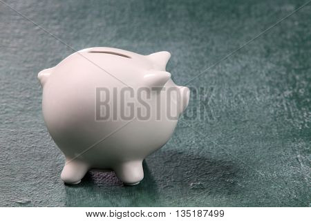 white piggy bank on the blackboard