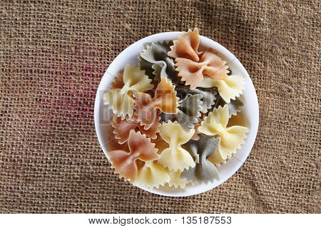 top view of farfalle on top of sack cloth