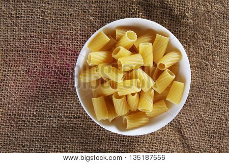 top view of tortiglioni on top of sack cloth