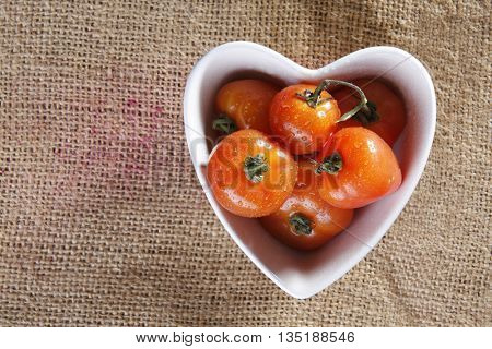 top view of the cherry tomatoes in heart shape container