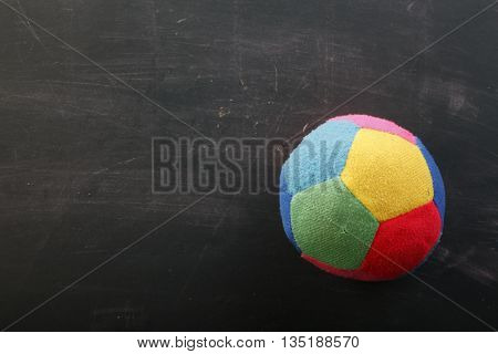 baby toy on the blackboard