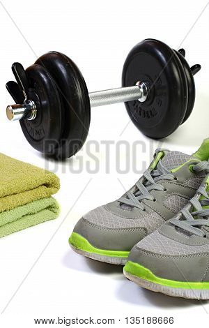 Dumbbell sport shoes and towel on white background