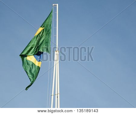Brazil's flag waving in a windy afternoon