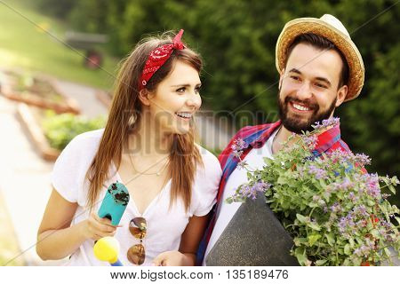 Picture of young couple working in the garden