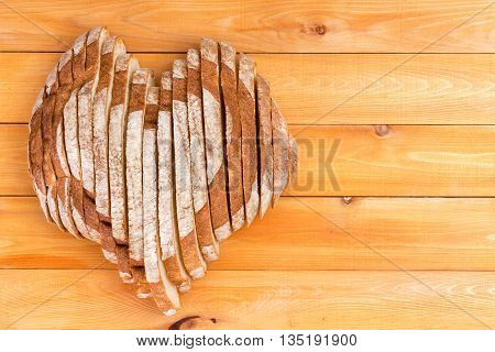 Homemade Bread Shaped As Heart On Picnic Table