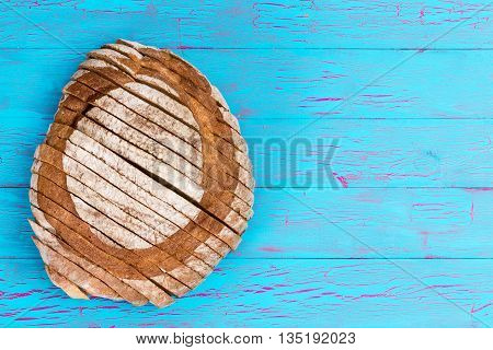 Homemade Bread Loaf On Crackled Blue Table Surface