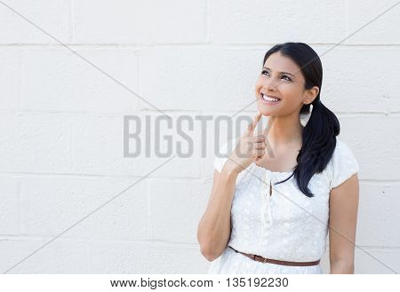 Closeup portrait charming upbeat smiling joyful happy young woman looking upwards daydreaming something nice isolated outdoors white background. Positive human facial expressions feelings