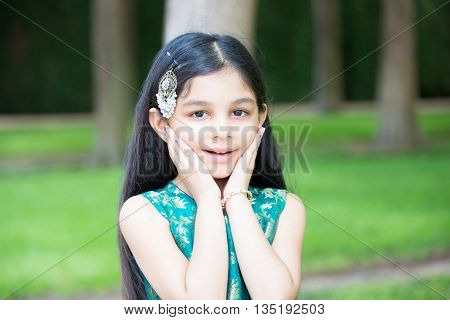 Closeup portrait young girl surprised by what she sees isolated outdoors outside background
