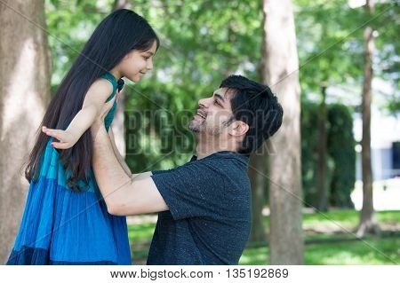 Closeup portrait single dad and child having some fun outside in park isolated outdoors background.