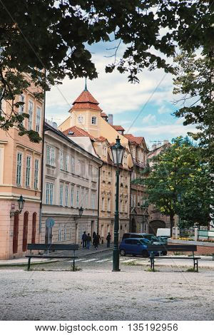 Corner of the street with stylish tenement house at Prague.