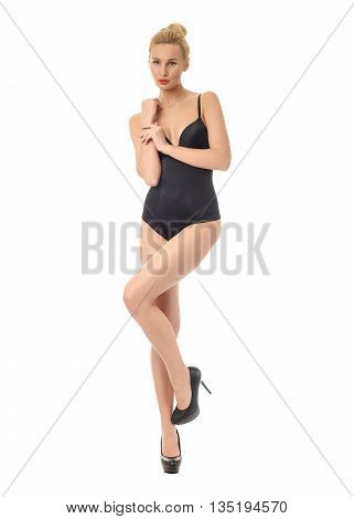 Portrait of slim sexy girl in black bodysuit posing isolated on white background