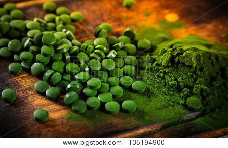 Healthy green young barley and chlorella, close-up.