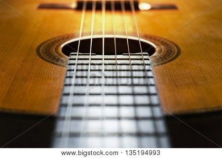Close-up of classical guitar strings, music concept