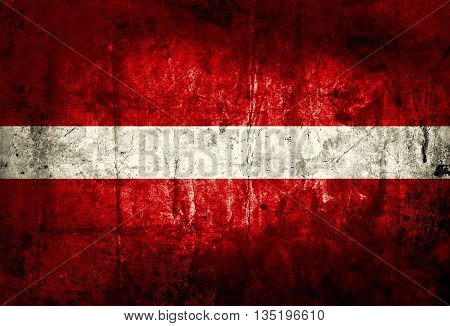 Grungy of Latvia flag on old paper texture background